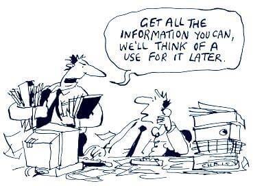 "Performance Metrics and Data Comic of two men at a desk with lots of papers, ""Get all the information you can, we'll think of a use for it later"""